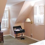Upstairs queen bedroom with dormer and brick detail.