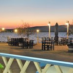 View from covered area, of outside seating & Gulf of Kalloni