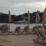 Pool area overlooking sea at hotel