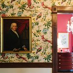 A portrait of former homeowner & signer of the Declaration Edward Rutledge hangs in the hall.