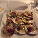 A wonderful starter of scallops with a rich seafood sauce and sun dried tomatoes