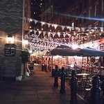 Outside dining on a fine night in NYC. The Dubliner on Stone St, near Battery Park.