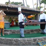 Presenting the roasted pig at luau