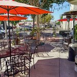 Outdoor dining patio at Les Amis in Fullerton, CA