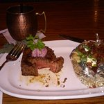 Filet mignon with a huckleberry compote on top & baked potato - Moscow Mule in real copper mug