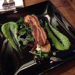 Seared scallops, pancetta, and pea texture swath