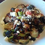 Deep fried brussel sprouts, combined with feta cheese, italian peppers, tomatoes and fresh spice