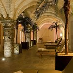 wellness area in 13th century cellars with sauna, steamroom and fitness