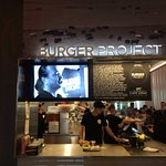 The newly open Burger Project at Chadstone Shopping Centre, with Neil Perry on screen