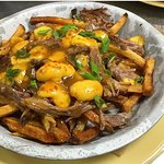 Roasted pork shoulder poutine. Ash county cheese curds, stout gravy!