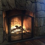 Wood burning fireplace in the lobby.