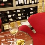 A seated place in amongst the most beautiful display of wine bottles