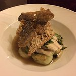 Poached sea bass with potato gnocchi, miso soup and chilli prawn toast