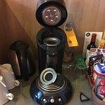 Dirty kettle, coffee maker & leaking shower.