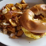 Bagel breakfast sandwich with scrambled eggs, bacon and cheese