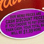 Pay cash to avoid the surcharge.