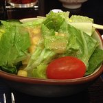 Green salad side dish with curry pork cutlet