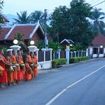 Monks bless the homes of those giving alms