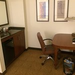 Inside the room; coffee making area/bar with empty mini-fridge, office desk with cordless teleph