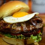 Steak Burger: 150g flame grilled imported rib eye steak, bacon, egg, grilled onion, beetroot, to
