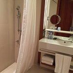 We liked the small magnifying mirror mounted on the left. Towels located under sink.