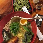 Delicious tonkotsu, pork belly, miso egg with kale, scallions. Edamame charred with hint of salt