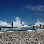 Get splashed by waves