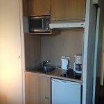 The kitchenette area with a small refrigerator.