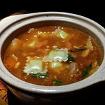 Lamb cocotte with cheese ravioli