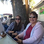 Wife and daughter at an outside table.