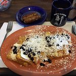 Stuffed French toast with coconut, blueberries and sausage with coffee