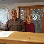 My gracious hosts, Harry and his lovely wife. Harry and me standing behind his desk. Note the lo