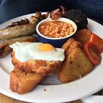 £10 full English. Takes about 20 - 30 mins between ordering and serving.