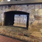 They eliminated wood burning fireplace instead they are using gas with bricks.  How much does th