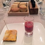 Starters of homemade breads, olives, tomato flat bread and gazpacho shot