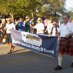 Scottish American Society joins parade-goers celebrating Dunedin's Scottish heritage.