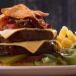 Mexican Burger with chilli con carne, nachos, guacamole and a slice of melted cheese