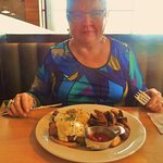 Prime rib eggs Benny with fried potatoes