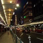 An evening view of Shijo Dori with roof-covered sidewalks (with plenty of lights)