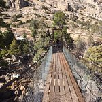 Swinging bridge across the Popo Agie River that leads to nature trail.