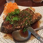 Fried Seabass steak with ginger and green onion sauce. Delicious - a must try!