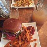 Burger and panini with carafe of mimosas