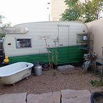 Outdoor patio with cool trailer and outdoor tub.