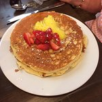 Lemon Pancakes topped with lemon topping and strawberries