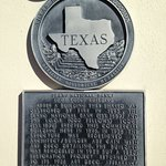 Plaque on a wall in Historic Downtown Plano Texas