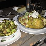 Sauteed brussel sprouts & veggie nachos with goat cheese, sour cream, guacamole.