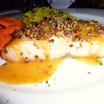 pecan encrusted salmon with wild rice and maple infused carrots