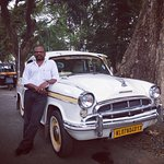 Antony, our driver in his wonderful 1958 Ambassador available at the hotel.