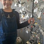 My daughter placing her wish cat on the tree ... such a sweet idea x