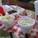 Creamed corn, potato salad, red potatoes, peach cobbler, and chopped BBQ.